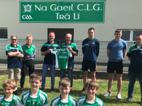Michael Brick accepting a set of jerseys for the Na Gaeil U11 football team from Harold Tansley of Tralee Carpet and Furniture Centre, at the club grounds on Sunday. Front row; James Tansley, Danny Brick, Philip Doyle & Eoin Tansley Back Row: Coiste na nÓg chairperson Colm O Súilleabháin, Helen Tansley, Harold Tansley, Michael Brick, Jack Barry, Diarmuid O'Connor & club chairperson Tim Lynch Jnr.