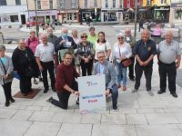 In front; David Scott and Ken Tobin of Tralee Chamber with, at back, Billy Nolan (masked) and some of the volunteers who will man the Tourism Kiosk in The Mall starting from Monday. Photo by Dermot Crean
