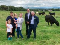 Kerry IFA Chairman, Kenny Jones and Cllr. Fionan Fitzgerald, Cathaoirleach of Castleisland/Corca Dhuibhne Electoral Area, with the O'Flaherty family.