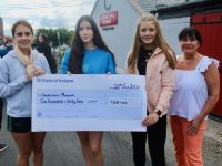 Lisa Cassidy, Aoife Greaney and Molly McDaid present a cheque for €650 to Gráinne Landers of the Spa Fenit Community Council. Photo by Dermot Crean