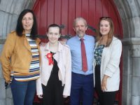 Aisling Byrne, with Yvonne and Eddie Byrne and Aoife McDonald, at the CBS Primary School Confirmation Day at St John's Church on Saturday. Photo by Dermot Crean