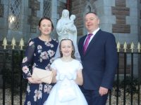Caherleaheen NS pupil, Hanna O'Sullivan who made her First Holy Communion at the St John's Church on Saturday morning, with Joanna and Niall O'Sullivan. Photo by Dermot Crean