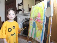 A young artist at the 'Me And The Moon' event in Collis Sandes House. Photo by Dermot Crean
