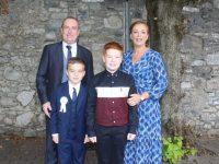 Gearóid Ó Laitheasa, with Gavin, Ruairí and Siobhan Lacey, at the Gaelscoil Mhic Easmainn Communion Day on Saturday at St John's Church. Photo by Dermot Crean