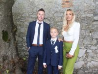 Jason O'Callaghan with Jamie Lawlor and Áine O'Callaghan at the Mercy Moyderwell Primary School First Holy Communion Day at St John's Church on Saturday. Photo by Dermot Crean