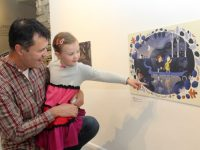 Jonathan Kelliher and daughter Aisling looking at one of the pieces at the Samhain Exhibition 'A Way Home - An Slí Abhaile' at Siamsa Tíre on Thursday. Photo by Dermot Crean
