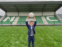 Eoin McClure making his first holy communion both stood in and in front of the brand new stand finished that Saturday morning.